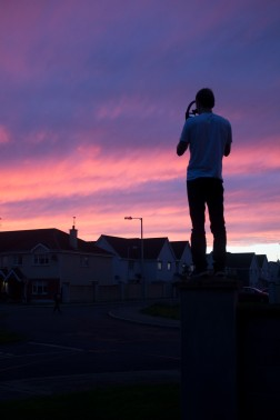 CIan Moynan capturing the sunset on camera.
