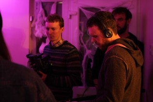 Cian Moynan, Cian O Brien and Tom Ryan shooting a house party scene.