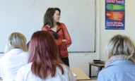 Actor Aoife Spratt filming a scene in the classroom.